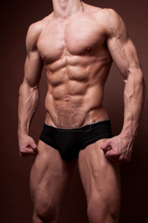 Photo for Muscled male torso with strong abs - Royalty Free Image
