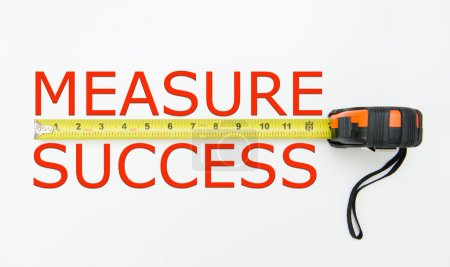 Photo for Measure of success conceptual using measuring tape - Royalty Free Image