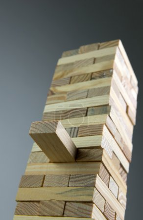 Photo for Accomplishment and team building concept using tower of wooden blocks - Royalty Free Image