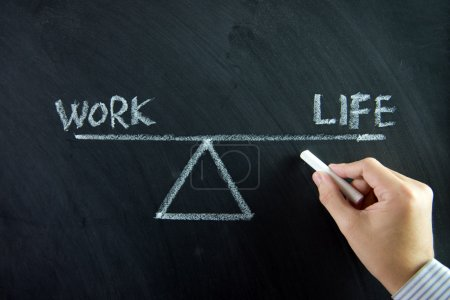 Work and life balance written on chalkboard...