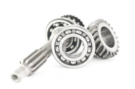 Stainless bearing, shaft and cogwheel isolated on white backgro