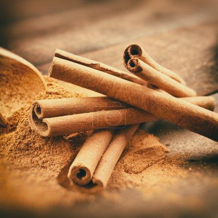 Vintage stylized photo of Cinnamon sticks and cinnamon powder