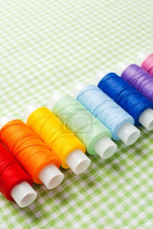 Row of thread spools in rainbow colors