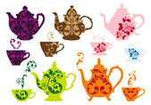 tea pots and cups with baroque pattern vector