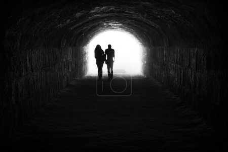 Photo for Couple and light in the end of the tunnel. Hope and freedom - Royalty Free Image