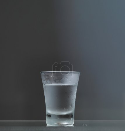 Photo for Cold vodka glass on grey background - Royalty Free Image