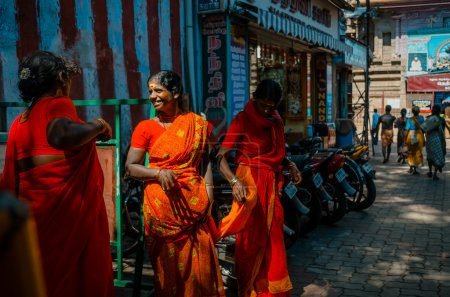 People on the city street in Madurai, Tamil Nadu, India.