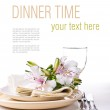 Table setting with white alstroemeria flowers, nap...