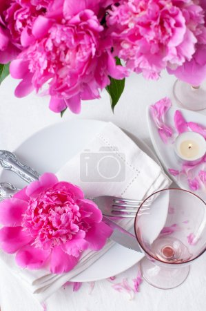 festive table setting with pink peonies