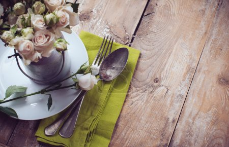 Vintage table setting with rose flowers