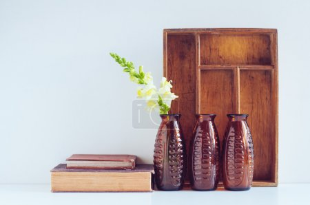 Photo for Vintage home decor, three brown glass flower vases, wooden box and old books on a white background. - Royalty Free Image