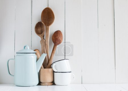 Photo for Home kitchen still life: Vintage coffee pot, enamel mugs and antique rustic wooden spoons on a barn wall background, soft pastel colors. - Royalty Free Image