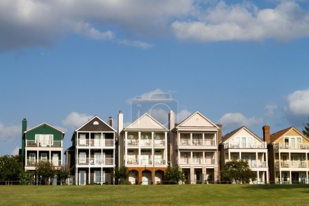 Upscale townhomes for the wealthy built on a grass...