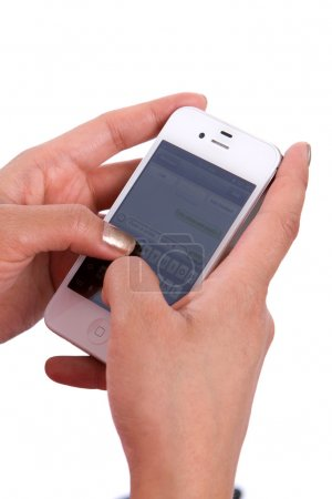 Photo for Woman's hands hold a cell phone while texting a message. - Royalty Free Image