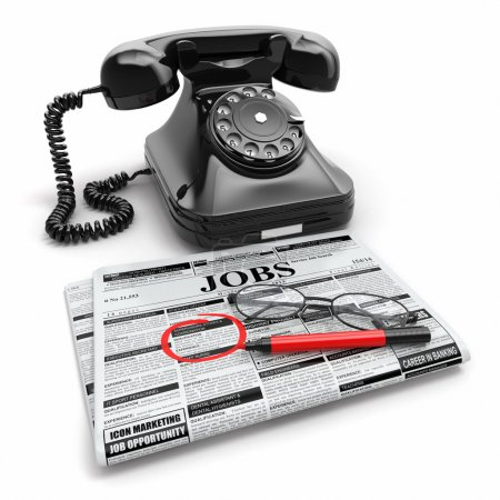 Search job. Newspaper with advertisments, glasses and phone