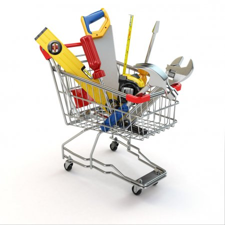 Photo for E-commerce. Tools and shopping cart on white isolated background. 3d - Royalty Free Image
