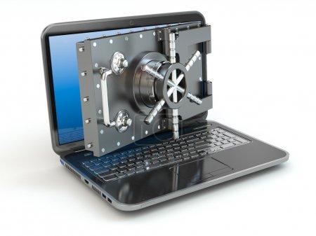 Internet security.Laptop and opening safe deposit box's door.