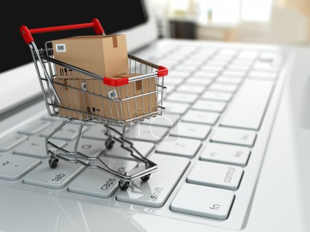 Photo for E-commerce. Shopping cart with cardboard boxes on laptop. 3d - Royalty Free Image