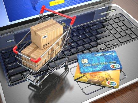 Photo pour Commerce électronique. Panier d'achat et cartes de crédit sur ordinateur portable. 3d - image libre de droit