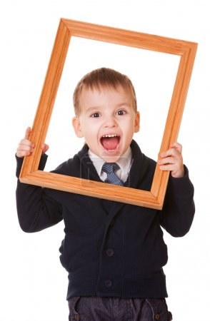 Photo for Shouting caucasian boy, holding a wooden picture frame. Isolated on white background - Royalty Free Image