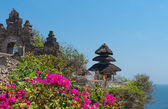 Balinese temple and pink flowers