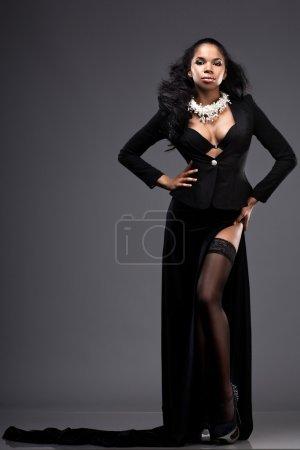 beautiful fashionable woman in black dress