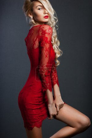 beautiful fashionable woman in red dress