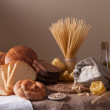Still life with bread, pasta and wheat...