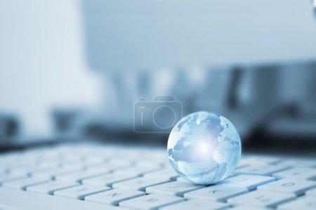 transparent globe on a keyboard