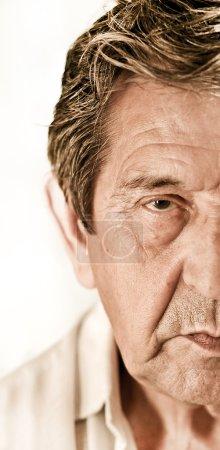 Elderly sad man's face