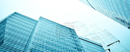 Photo for Panoramic and perspective wide angle view to steel blue background of glass high rise building skyscrapers in modern futuristic downtown at night Business concept of successful industrial architecture - Royalty Free Image