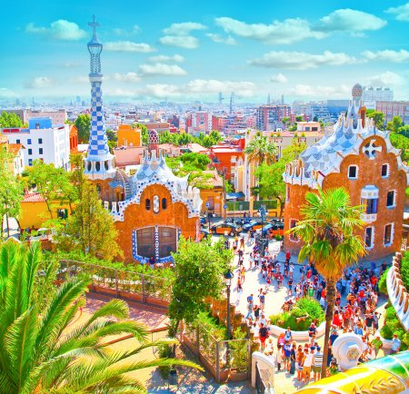 The Famous Summer Park Guell over bright blue sky in Barcelona,