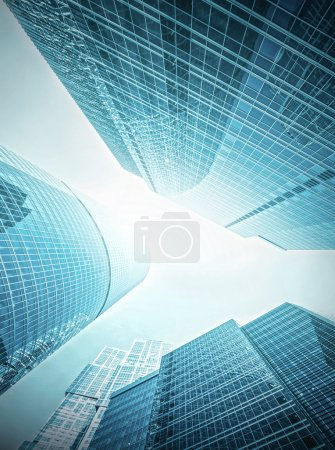 Photo for Panoramic and prospective wide angle view to steel light blue background of glass high rise building skyscraper commercial modern city of future. Business concept of successful industrial architecture - Royalty Free Image