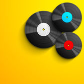 Musical concept with vinyl disc on yellow background