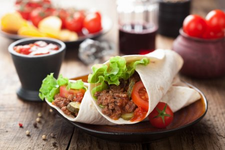 Photo for Tortilla wraps with meat and vegetables - Royalty Free Image