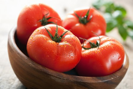 Photo for Fresh beef tomatoes in bowl - Royalty Free Image