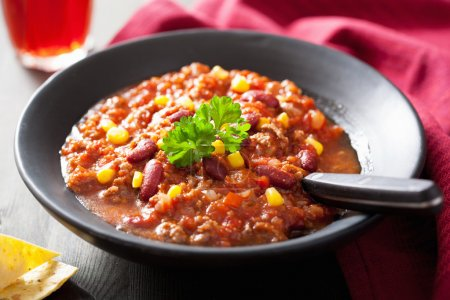 Photo for Mexican chili con carne in black plate - Royalty Free Image
