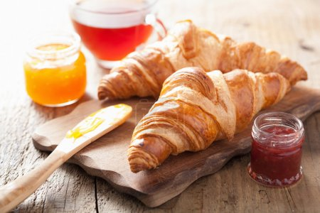 Photo for Fresh croissants with jam for breakfast - Royalty Free Image