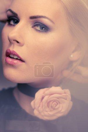 Beautiful woman with rosebud