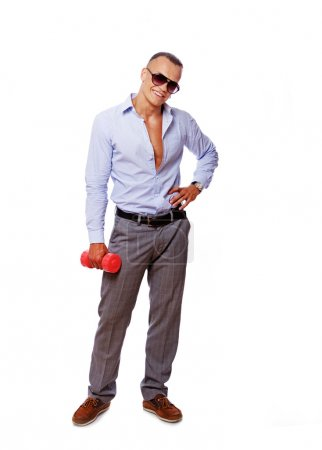 Portrait of hansome man posing in studio with dumbbells