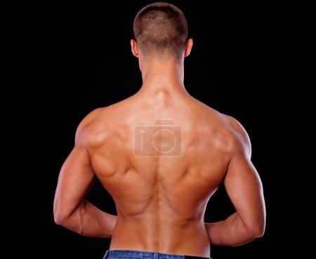 A photo of an athletic man shot from the back