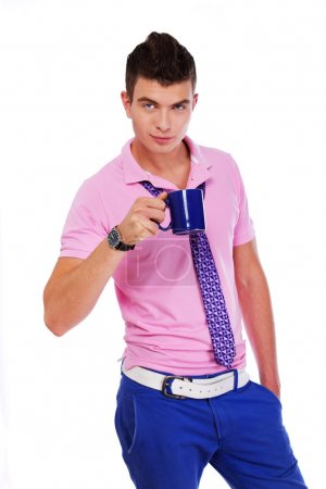 Photo for Picture of stylish young man with a blue cup - Royalty Free Image