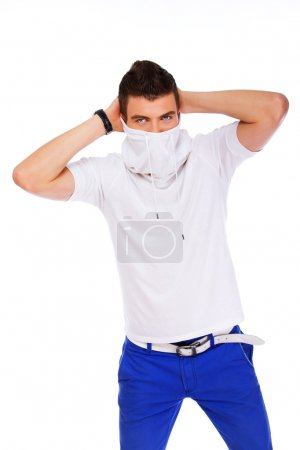 Photo pour Un jeune homme cache son visage - image libre de droit
