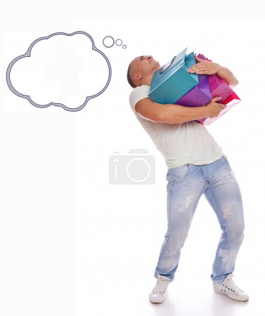 Photo pour Image of man who is holding heavy bags and can't think about something else - image libre de droit