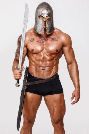 Photo pour Image de guerrier avec un corps bien regardé - image libre de droit