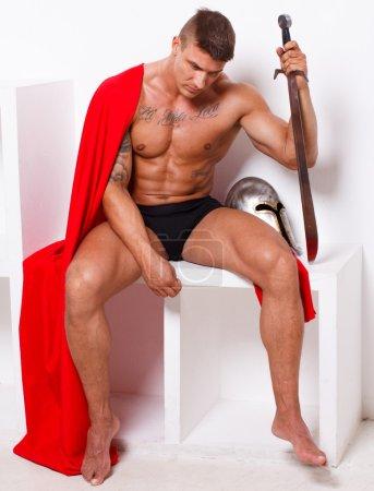 Photo pour Image du guerrier qui est assis et ayant res - image libre de droit