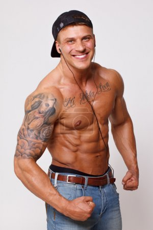 Hot guy with sexy body is demonstrating his biceps