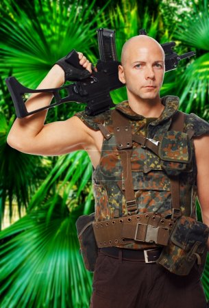 Armed soldier in uniform in the jungles