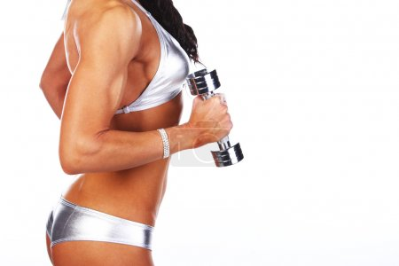 Photo for Image of female body and dumbbell - Royalty Free Image