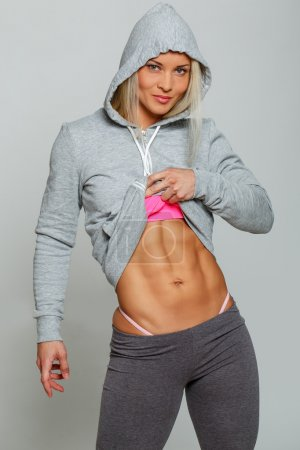 Woman in sportswear with cool abs